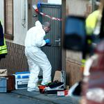 A forensic expert works at a crime scene where two people died during a police operation in Kirchheim