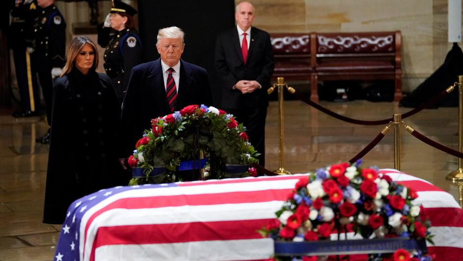 President Donald Trump and first lady Melania Trump pay their respects to former President George H. W. Bush lying in state in the U.S. Capitol Rotunda