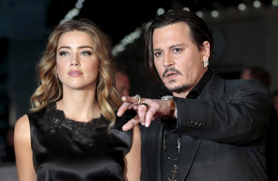 "File photo of cast member Johnny Depp and his actress wife Amber Heard arrive for the premiere of the British film ""Black Mass"" in London 