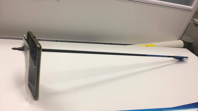 A picture shows an arrow that pierced a mobile telephone after accident in Nimbin