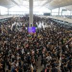 Anti-extradition bill protesters rally at the departure hall of Hong Kong airport in Hong Kong