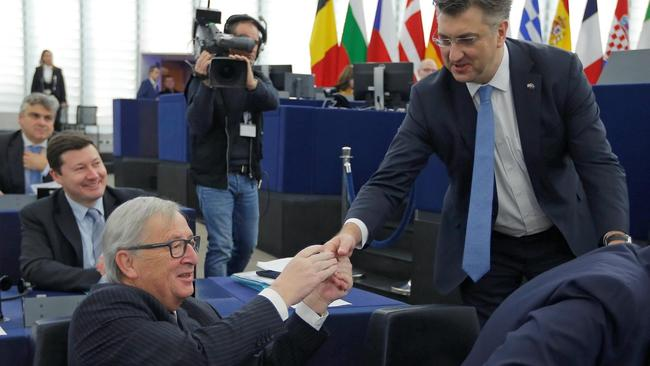 Croatia's Prime Minister Plenkovic shakes hands with European Commission President Juncker as he arrives to deliver a speech during a debate on the Future of Europe at the European Parliament in Strasbourg