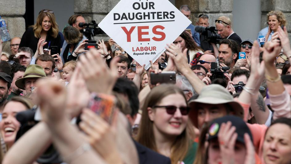 People celebrate the result of yesterday's referendum on liberalizing abortion law, in Dublin