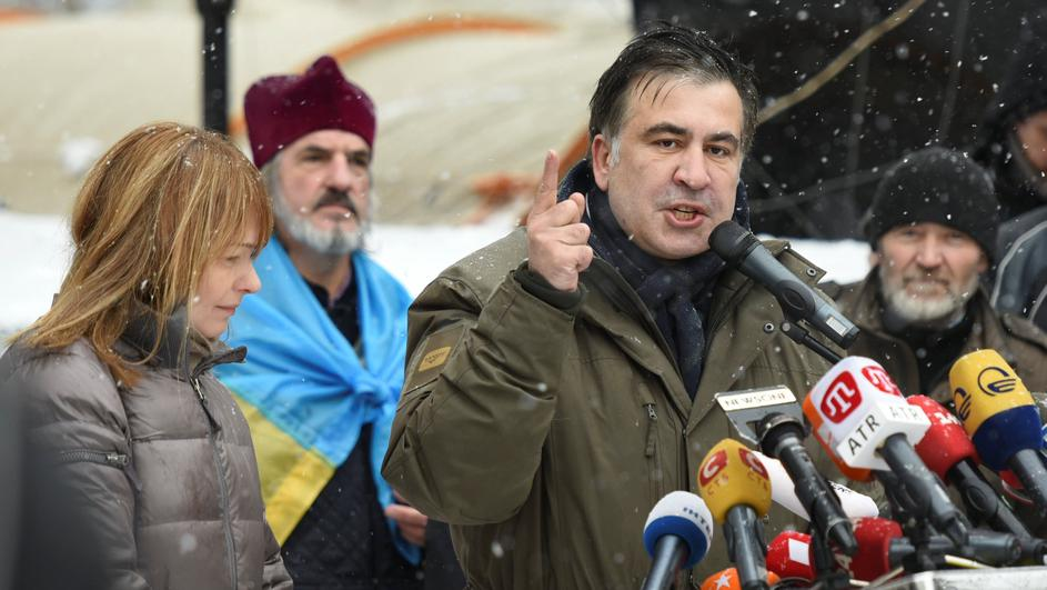Former Georgian President Mikheil Saakashvili, accompanied by his wife Sandra Roelofs, addresses his supporters in front of the Parliament building in Kiev