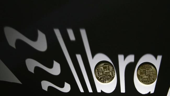 FILE PHOTO: FILE PHOTO: Shadow of a 3D-printed Facebook Libra cryptocurrency logo is seen near cryptocurrency representation in this illustration taken