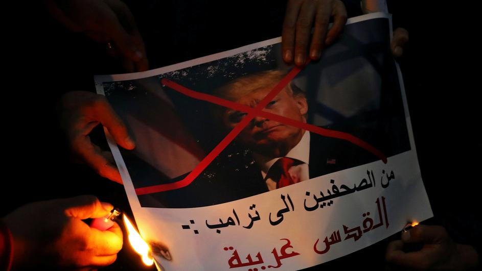 "People burn a poster of Trump reading ""Journalists are telling you Trump, Jerusalem is Arab"" during a protest against Trump's Jerusalem declaration, in front of the Syndicate of Journalists in Cairo"