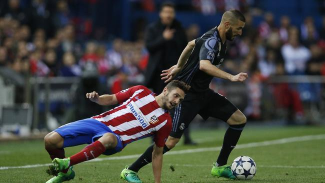 Real Madrid's Karim Benzema in action with Atletico Madrid's Koke