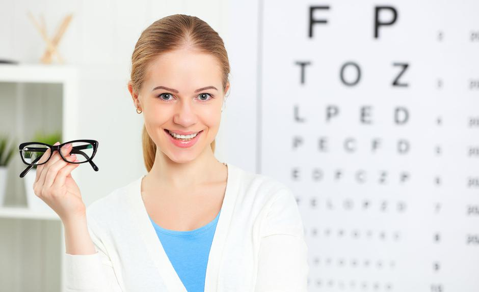 eyesight check. woman with glasses at doctor ophthalmologist optician | Autor: evgeny atamanenko