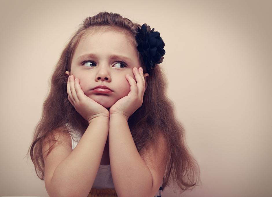 Beautiful child girl looking sad with pouted lips. Closeup | Autor: Dreamstime