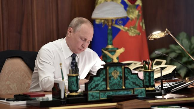 Russian President Putin works in his cabinet before an inauguration ceremony at the Kremlin in Moscow