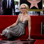 Actor Anderson poses on her star after it was unveiled on the Hollywood Walk of Fame in Los Angeles