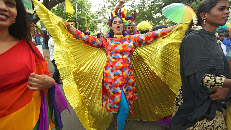 Participants dance during a gay pride parade promoting lesbian, gay, bisexual and transgender rights, in Chennai