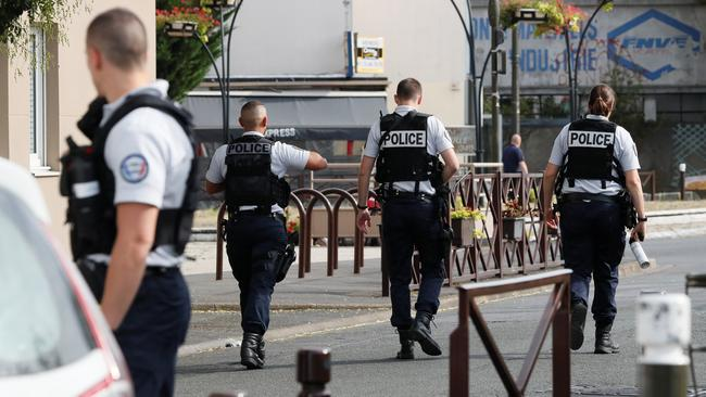 Police secure the area during an operation after components that can be used to make explosives were found in a flat in Villejuif