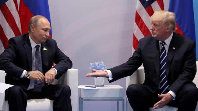 FILE PHOTO: U.S. President Donald Trump meets with Russian President Vladimir Putin during their bilateral meeting at the G20 summit in Hamburg