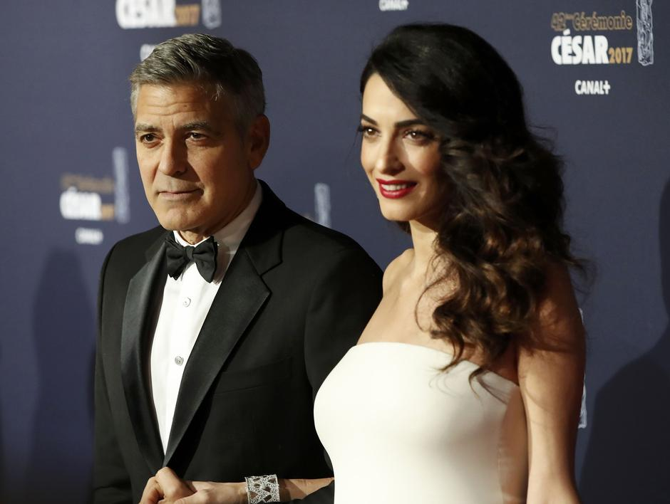 Actor George Clooney and his wife Amal pose as they arrive at the 42nd Cesar Awards ceremony in Paris | Autor: GONZALO FUENTES/REUTERS/PIXSELL/REUTERS/PIXSELL