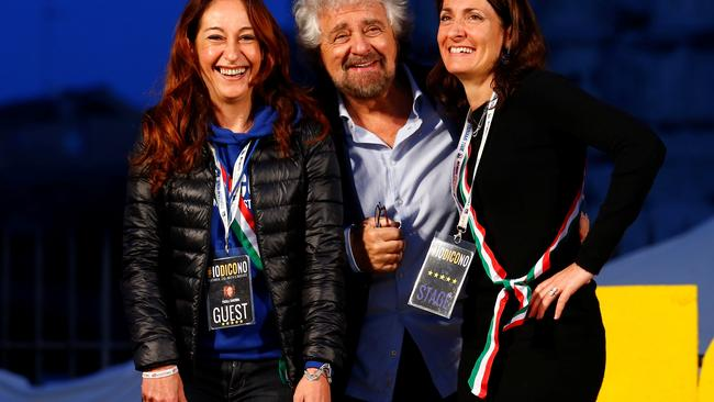 Beppe Grillo, the founder of the anti-establishment 5-Star Movement, is seen with members of the Movement during a march in support of the 'No' vote in the upcoming constitutional reform referendum in Rome