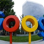 FILE PHOTO: The logo of Alphabet Inc's Google outside its office in Beijing