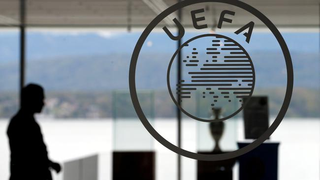 FILE PHOTO: A logo is pictured on UEFA headquarters in Nyon