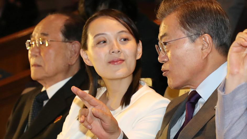 South Korean President Moon Jae-in talks with Kim Yo Jong, the sister of North Korea's leader Kim Jong Un, while watching North Korea's Samjiyon Orchestra's performance in Seoul