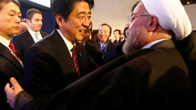 FILE PHOTO: Japan's Prime Minister Abe greets Iran's President Rouhani  at World Economic Forum in Davos