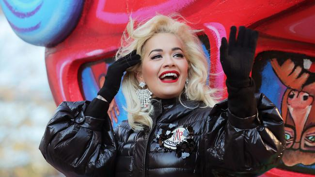 Singer Rita Ora waves to the crowd during the Macy's Thanksgiving Day Parade in Manhattan