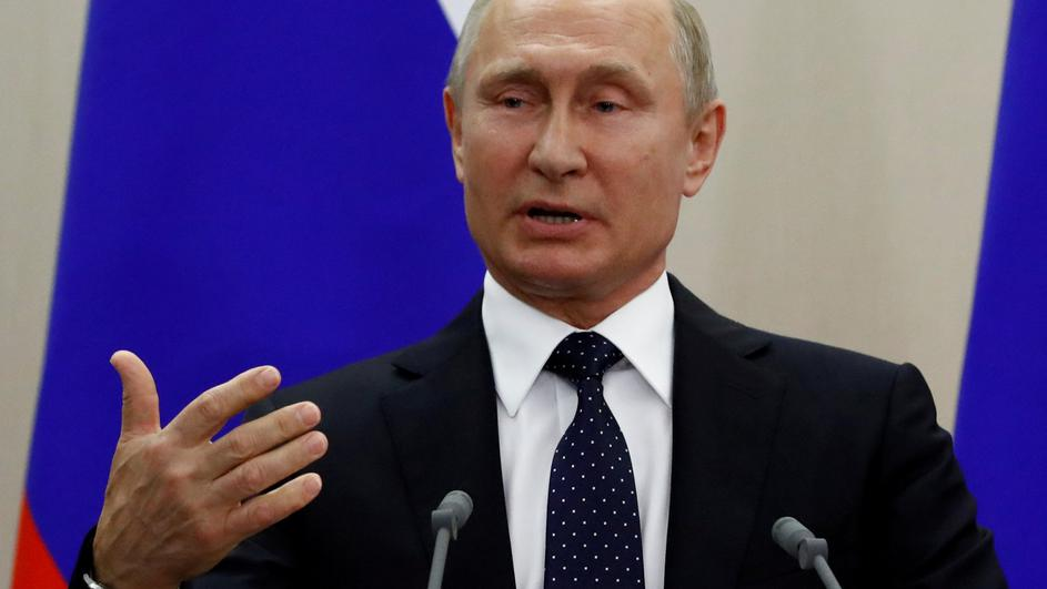 FILE PHOTO: Russian President Putin speaks at a news conference