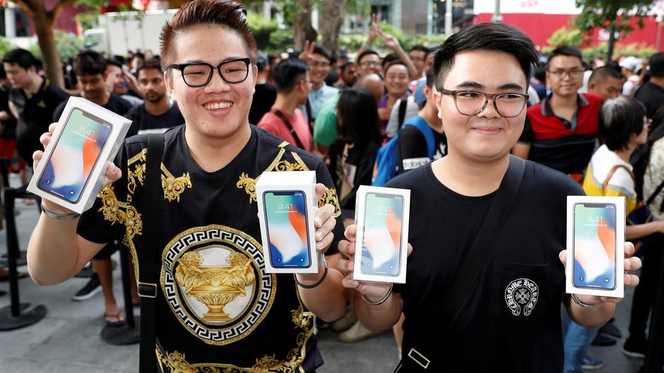 First customers to buy iPhone X Kittiwat Wang, 22, and Mod, 22, of Bangkok pose with their iPhone X at the Apple store in Singapore