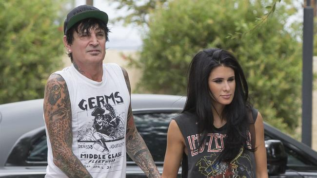 *EXCLUSIVE* Tommy Lee and Brittany Furlan hold hands as they stop by a dermatologist