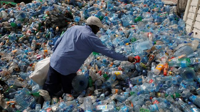 An employee sorts plastic bottles at the Weeco plastic recycling factory at the Athi River industrial zone near Nairobi