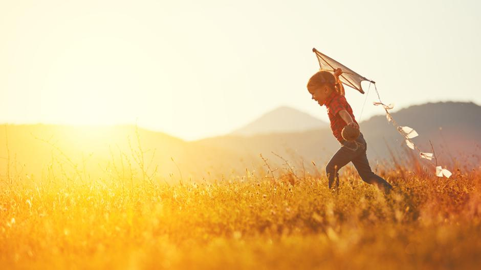 happy child girl with a kite running on meadow in summer | Autor: evgeny atamanenko