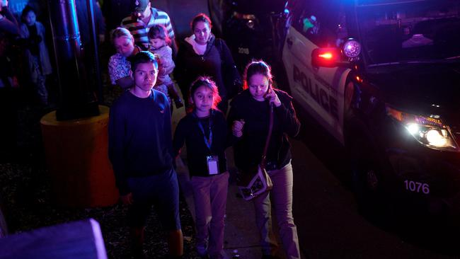 Families who were shopping during a  a shooting at a Walmart leave the scene in Thornton