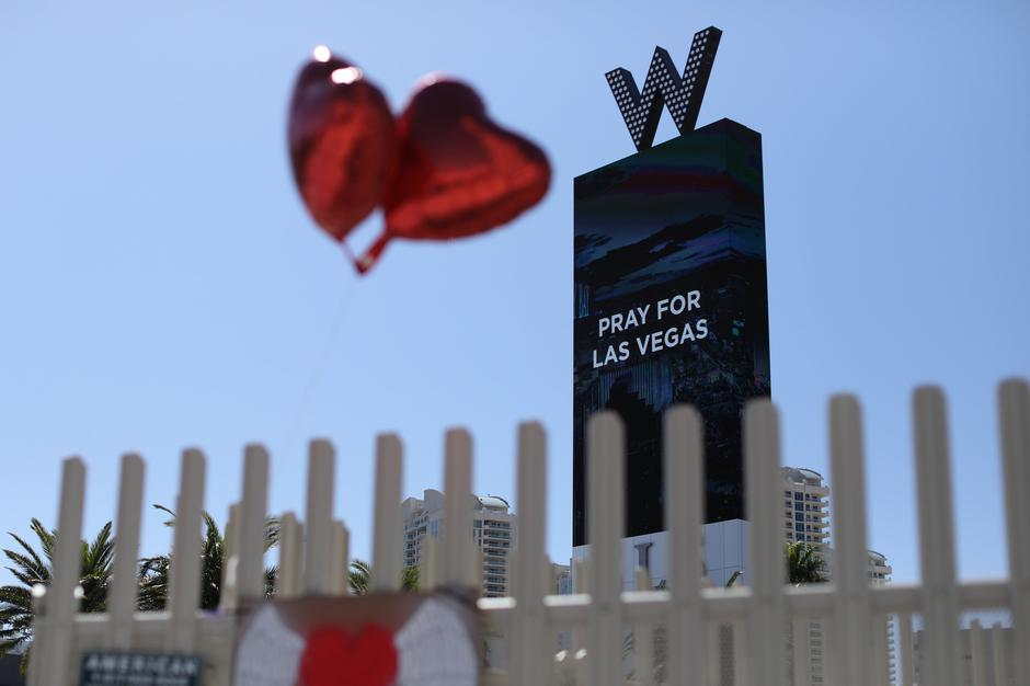 "Balloons fly near a ""Pray for Las Vegas"" message along Las Vegas Boulevard after a mass shooing on the Las Vegas Strip in Las Vegas 