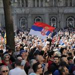 Demonstrators attend a protest against Serbian President Vucic and his government in front of the presidential building in Belgrade