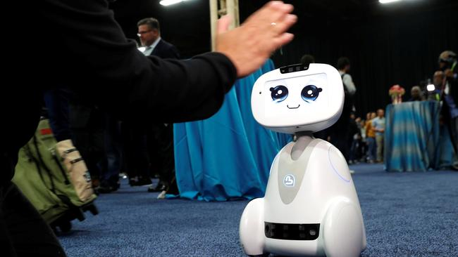 Buddy, an entertainment and assistant robot by Blue Frog Robotics, interacts with a attendee during CES Unveiled at the 2018 CES in Las Vegas
