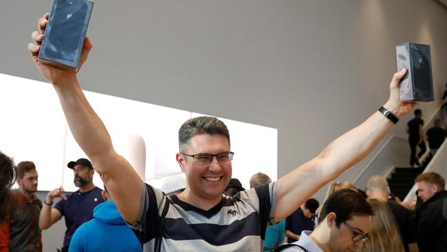 One of the first customers celebrates his purchase of the new iPhone 8 at the 5th Avenue Apple store in New York