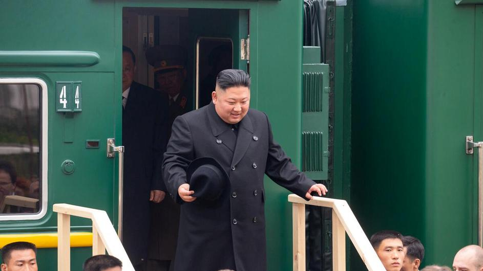 North Korean leader Kim Jong Un takes part in a welcoming ceremony at a railway station in Khasan