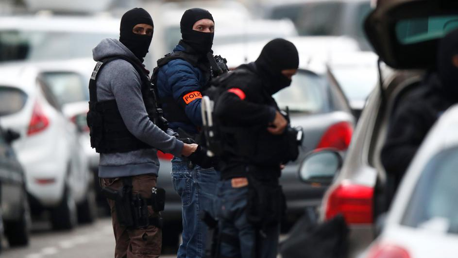 French special police forces secure a street during a police operation in the Neudorf district after the deadly shooting in Strasbourg