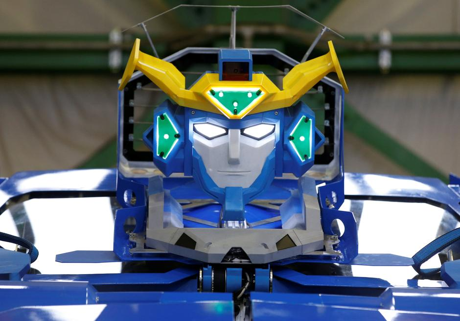 "New transforming robot called ""J-deite RIDE"" that transforms itself into a passenger vehicle, developed by Brave Robotics Inc, Asratec Corp and Sansei Technologies Inc, is unveiled at a factory near Tokyo 